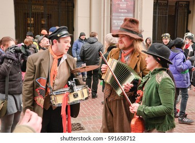 MOSCOW, RUSSIA - MARCH 17, 2012: The carnival procession in the St. Patrick's Day on Arbat street. Street musicians
