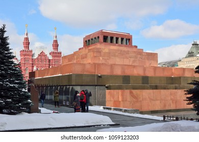 Moscow, Russia - March 17, 2018. Exterior view of Lenin's Mausoleum on the Red Square in Moscow, with statue and people.