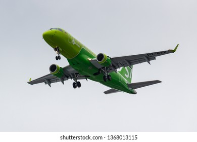 Moscow, Russia - March 17, 2019: Aircraft Embraer ERJ-170SU (ERJ-170-100 SU) VQ-BYV of S7 - Siberia Airlines going to landing at Domodedovo international airport in Moscow against gray sky
