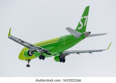 Moscow, Russia - March 17, 2019: Aircraft Embraer ERJ-170SU (ERJ-170-100 SU) VQ-BYM of S7 - Siberia Airlines going to landing at Domodedovo international airport in Moscow against gray sky