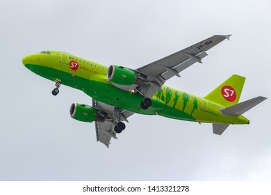 Moscow, Russia - March 17, 2019: Aircraft Airbus A319-114 VP-BHI of S7 - Siberia Airlines going to landing at Domodedovo international airport in Moscow against gray sky