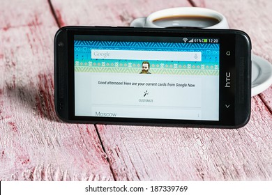 Moscow, Russia - March 18, 2014: Google app open in the mobile phone HTC.HTC Corporation main direction rapidly developing market of smartphones. Instagram free application sharing photos and videos