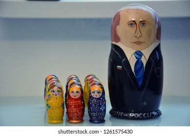 Moscow, Russia - March 18, 2016. A picture of Russian dolls symbolically picturing Russian president Vladimir Putin and a crowd of citizens.