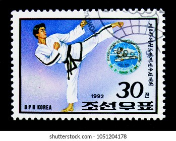 MOSCOW, RUSSIA - MARCH 18, 2018: A stamp printed in Democratic People's Republic of Korea shows Taekwondo sportsman, 8th World Taekwondo Championship, Pyongyang serie, circa 1992