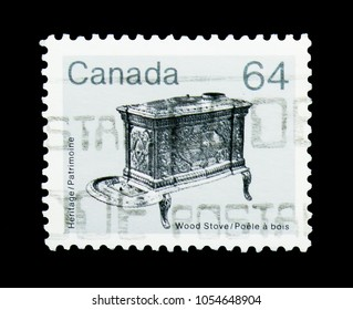 MOSCOW, RUSSIA - MARCH 18, 2018: A stamp printed in Canada shows Wood stove, Heritage Artifacts serie, circa 1983