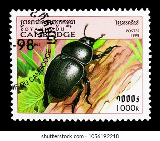MOSCOW, RUSSIA - MARCH 18, 2018: A stamp printed in Cambodia shows Dung Beetle (Geotrupes sp.), Insects serie, circa 1998