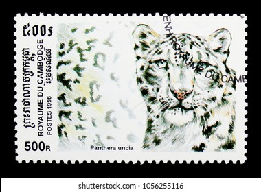 MOSCOW, RUSSIA - MARCH 18, 2018: A stamp printed in Cambodia shows Snow Leopard (Panthera uncia), Wild Cats serie, circa 1998