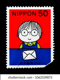 MOSCOW, RUSSIA - MARCH 18, 2018: A stamp printed in Japan shows Boy and letter, I received a letter, Letter Writing Day serie, circa 1998