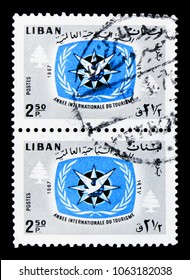 MOSCOW, RUSSIA - MARCH 18, 2018: A stamp printed in Lebanon shows Two postage stamps, ITY Emblem and Cedars, International Tourist Year 1967 (II) serie, circa 1967