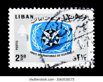 MOSCOW, RUSSIA - MARCH 18, 2018: A stamp printed in Lebanon shows ITY Emblem and Cedars, International Tourist Year 1967 (II) serie, circa 1967