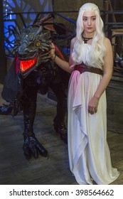 """MOSCOW, RUSSIA, MARCH 19-20, 2016: Festival """"ROSCON-2016"""" cosplayers: Daenerys and Black Dragon"""