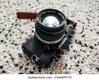 Moscow, Russia - March 20, 2019: Legendary Olympus OM-1 35mm film camera on the carpet