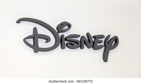 Moscow, Russia - March, 2015: Disney company logo sign. Grey plastic letters on the white wall
