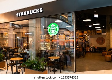 Moscow, Russia - March 2019: Starbucks Coffee Outlet In Moscow City Mall. Starbucks Is An American Global Coffee Company And Is Largest Coffeehouse Company In World.