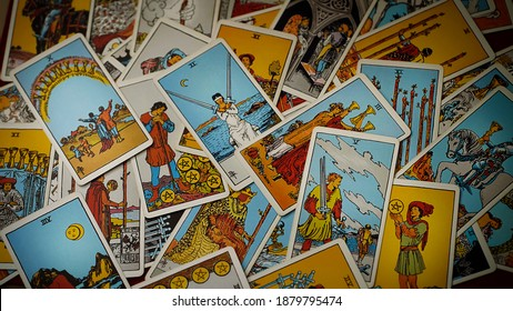 Moscow, Russia - March 2020: A pile of tarot trump cards jumbled, scattered and haphazardly arranged.