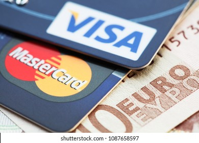 MOSCOW, RUSSIA - MARCH 23, 2014: Visa and MasterCard credit cards against Euro banknotes. Visa and MasterCard are major credit card companies in the world