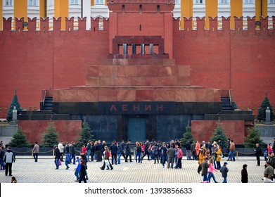MOSCOW, RUSSIA - MARCH 23, 2014: Tourists walking in front of the Mausoleum of Lenin and Kremlin wall on Red Square, Moscow, Russia on March 23, 2014