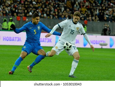 Moscow, Russia - March 23, 2018.  Russian midfielder Aleksei Miranchuk and Brazilian defensive midfielder Casemiro during international test match Russia vs Brazil in Moscow.