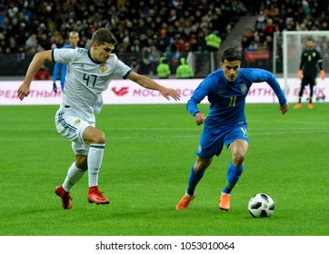 Moscow, Russia - March 23, 2018. Russian midfielder Roman Zobnin and Brazilian attacking midfielder Philippe Coutinho during international test match Russia vs Brazil in Moscow.