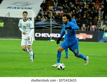 Moscow, Russia - March 23, 2018. Brazilian left back Marcelo and Russian midfielder Aleksei Miranchuk during international friendly Russia vs Brazil in Moscow.