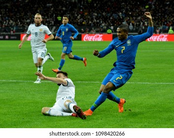 Moscow, Russia - March 23, 2018. Brazilian midfielder Douglas Costa and Russian defender Vladimir Granat  during international friendly Russia vs Brazil in Moscow.