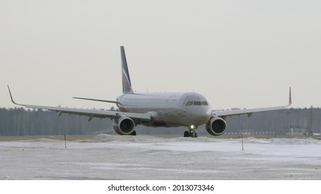 MOSCOW, RUSSIA - MARCH 23, 2018: Airplane Airbus A321 taxiing from the runway, spring view with snow. Aircraft of Aeroflot which is the largest Russian airline with fleet size of 255 planes