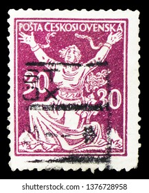 MOSCOW, RUSSIA - MARCH 23, 2019: A stamp printed in Czechoslovakia shows Breaking Chains to Freedom, Allegory of Republic serie, circa 1920