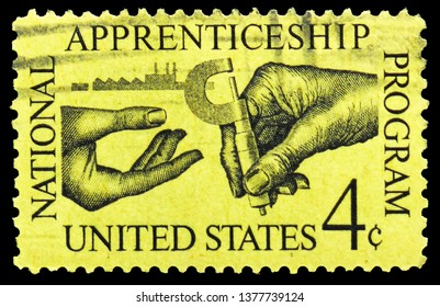 MOSCOW, RUSSIA - MARCH 23, 2019: A stamp printed in United States shows Machinist Handing Micrometer to Apprentice, Apprenticeship Issue serie, circa 1962