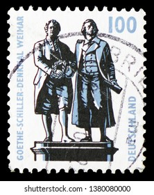 MOSCOW, RUSSIA - MARCH 23, 2019: A stamp printed in Germany, Federal Republic shows Goethe-Schiller Monument, Weimar, Sights serie, circa 1997