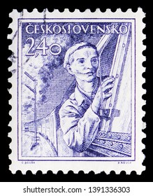MOSCOW, RUSSIA - MARCH 23, 2019: Postage stamp printed in Czechoslovakia shows Engine driver, Professions serie, circa 1954