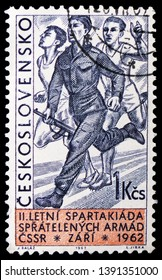 MOSCOW, RUSSIA - MARCH 23, 2019: Postage stamp printed in Czechoslovakia shows Soldier with rifle in relay race, 2nd Summer Spartacist Games of Friendly Armies, Prague serie, circa 1962