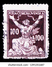 MOSCOW, RUSSIA - MARCH 23, 2019: Postage stamp printed in Czechoslovakia shows Breaking Chains to Freedom, Allegory of Republic serie, circa 1920