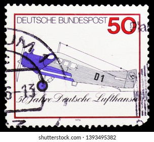MOSCOW, RUSSIA - MARCH 23, 2019: Postage stamp printed in Germany, Federal Republic shows Junkers F13 (1926), first Lufthansa passenger aircraft, Lufthansa (German civil airline) serie, circa 1976