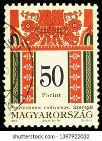 MOSCOW, RUSSIA - MARCH 23, 2019: Postage stamp printed in Hungary shows Folk motives of Szentgal, Hungarian Folk Art serie, circa 1994
