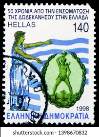MOSCOW, RUSSIA - MARCH 23, 2019: Postage stamp printed in Greece shows Colossus of Rhodes with Greek flag, Greek History serie, circa 1998