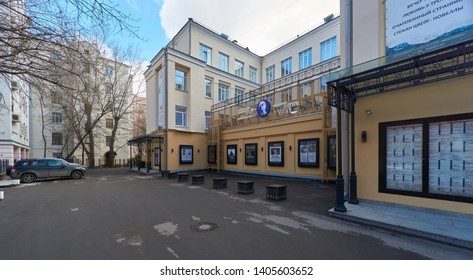 Moscow, Russia - March 23, 2019: State Academic Vakhtangov theater. Russian text with the name of the theater and playbills.