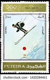 MOSCOW, RUSSIA - MARCH 23, 2019: Postage stamp printed in United Arab Emirates, Fujairah, shows Sapporo 1972, Winter Olympics 1924-1972, Advertising posters serie, circa 1972