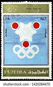 MOSCOW, RUSSIA - MARCH 23, 2019: Postage stamp printed in United Arab Emirates, Fujairah, shows Grenoble 1968, Winter Olympics 1924-1972, Advertising posters serie, circa 1972