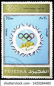 MOSCOW, RUSSIA - MARCH 23, 2019: Postage stamp printed in United Arab Emirates, Fujairah, shows Cortina d'Ampezzo 1956, Winter Olympics 1924-1972, Advertising posters serie, circa 1972