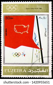 """MOSCOW, RUSSIA - MARCH 23, 2019: Postage stamp printed in United Arab Emirates, Fujairah, shows """"Squaw"""" Valley 1960, Winter Olympics 1924-1972, Advertising posters serie, circa 1972"""