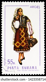 MOSCOW, RUSSIA - MARCH 23, 2019: Postage stamp printed in Romania shows Arges (female), Folk Costumes serie, circa 1969
