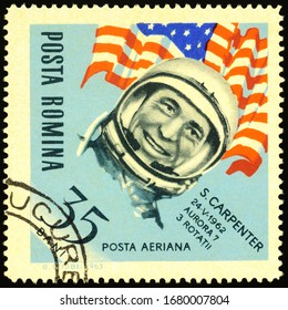 Moscow, Russia - March 23, 2020: stamp printed in Romania shows American astronaut Malcolm Scott Carpenter (1925-2013), the second American (after John Glenn) to orbit the Earth, circa 1963
