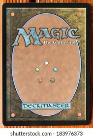 MOSCOW, RUSSIA - MARCH 24, 2013: Magic: The Gatherings card back typical design. The game was created by Richard Garfield and first published in 1993 by Wizards of the Coast.