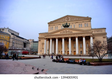 MOSCOW, RUSSIA - MARCH 24, 2014: People in froint of Bolshoi Theater during a day. Moscow famous landmark, The Bolshoi Theater, is a historic theater in Moscow, originally designed by architect Joseph