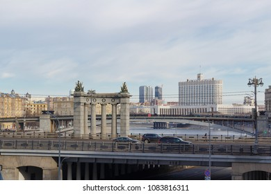 Moscow, Russia - March 25, 2018: Building of Russian Federation Government House against the backdrop of bridges across the Moskva river