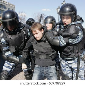 MOSCOW, RUSSIA - MARCH 26, 2017:  Police detain a protester at Pushkin Square during mass rally against corruption in Putin's government. .