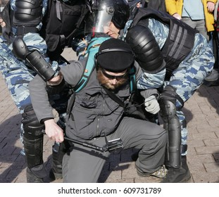 MOSCOW, RUSSIA - MARCH 26, 2017:  Police detain a man with a selfie stick at Pushkin Square during mass rally against corruption in Putin's government.