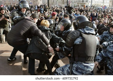 MOSCOW, RUSSIA - MARCH 26, 2017:  Police detain protesters at Pushkin Square during mass rally against corruption in Putin's government.