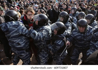 MOSCOW, RUSSIA - MARCH 26, 2017: Police detain a person at Pushkin Square during mass rally against corruption in Putin's government.