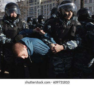 MOSCOW, RUSSIA - MARCH 26, 2017: Police officers detain a protester at Pushkin Square during mass rally against corruption in Putin's government.